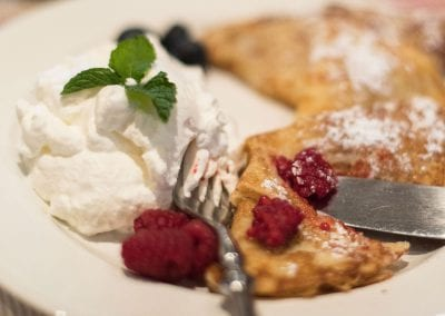 Crepe with whipped cream and raspberries
