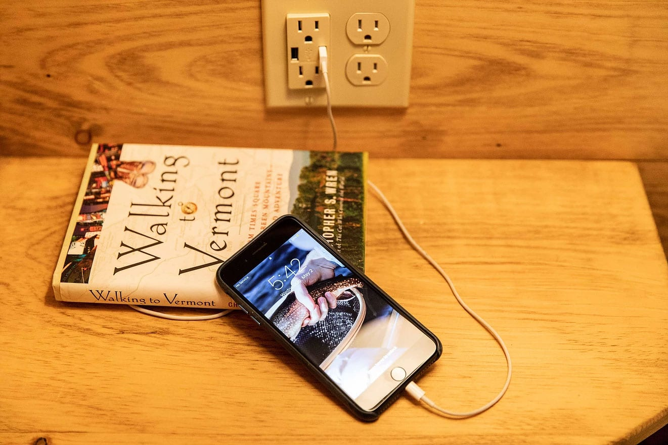 Plugged in cell phone on book