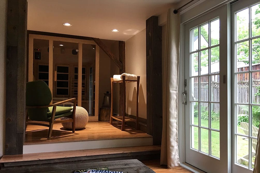 infrared sauna on the left, French sliding doors opening to a garden on the right