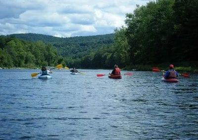 4 canoes on a lake