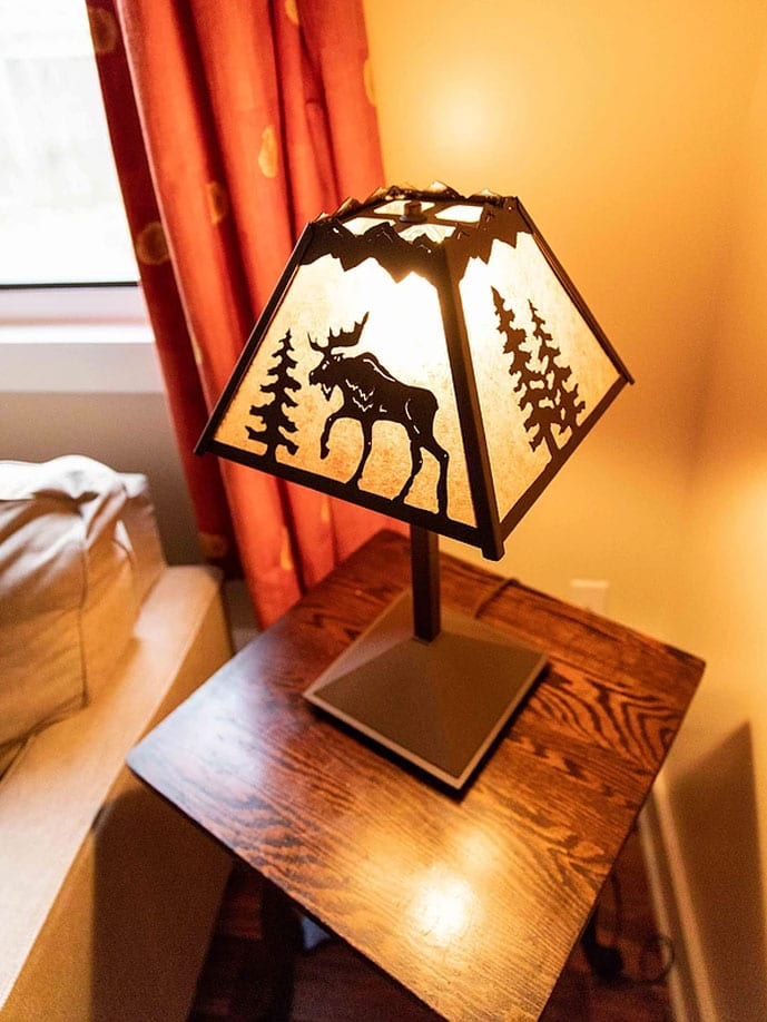 Lamp with moose on it on table