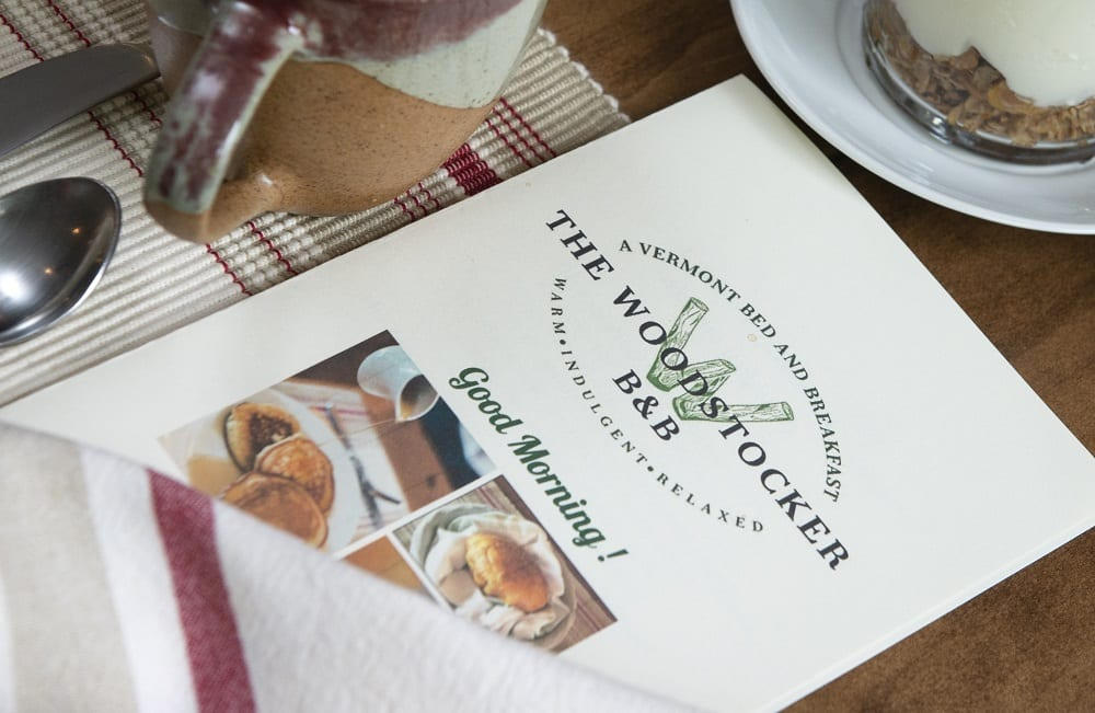 front page of the menu, with The Woodstocker logo and photo of a bread basket