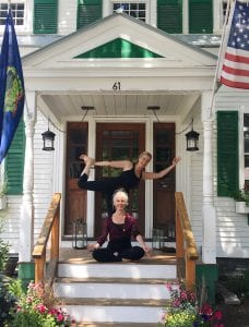 2 women in yoga pose on front steps