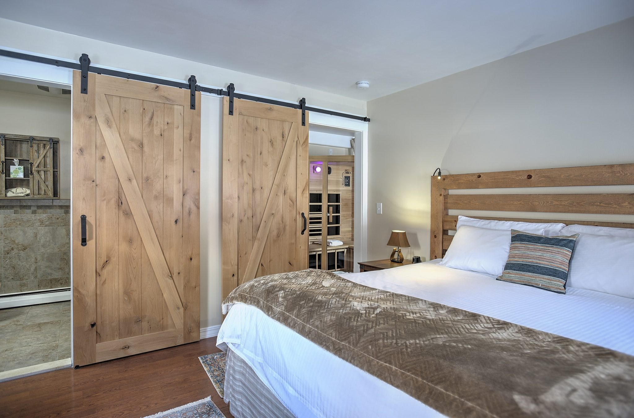 large bed and barn doors
