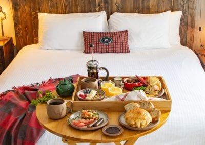breakfast on table in front of bed